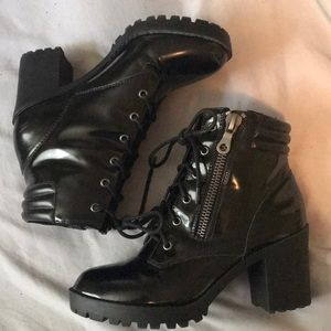 Black heeled patten leather boots